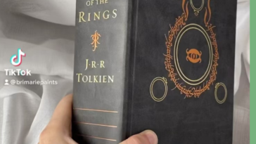 I paint scenes hidden under the gilding of books (fore edge painting). Here's a beautiful edition of LOTR.